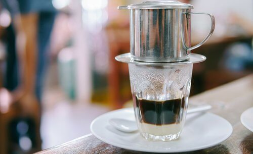 Vietnamese Coffee Drips onto Sweet Condesned Milk