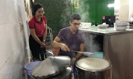 Rice paper cooking on our food tour