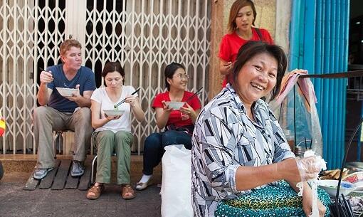 Saigon Food Tour eating on the Street