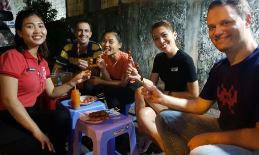 Walking Food Tour Guests on our Saigon Street Food Stroll