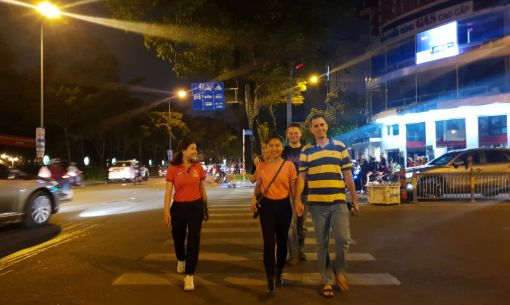 Exploring the Street of Saigon on our Walking Food Tour with our Local Guide